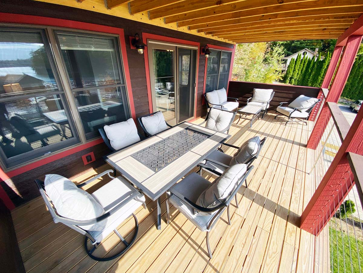 Large deck with sitting area and outside dining