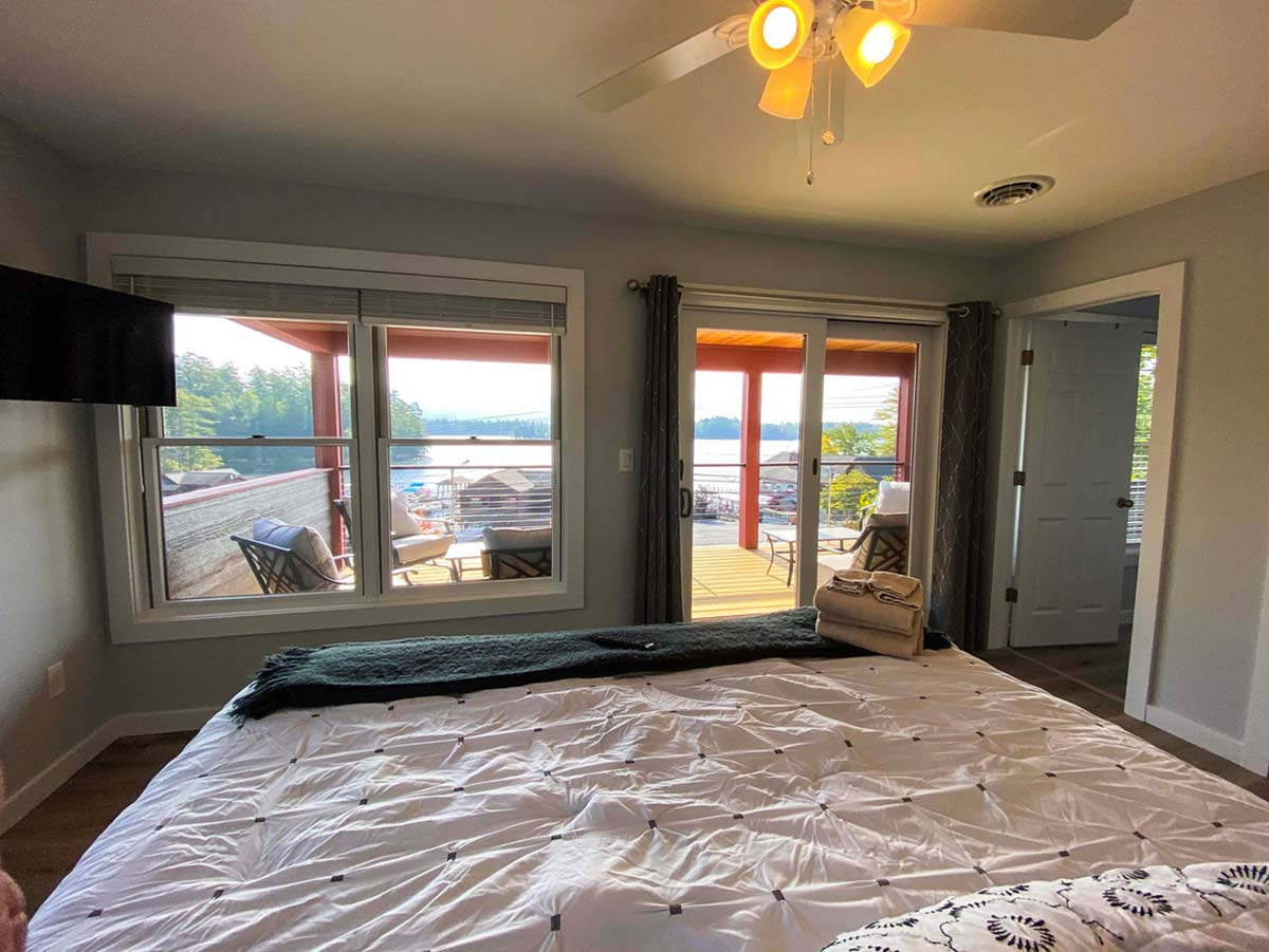 Large windows and sliding glass door offers great views of Lake George