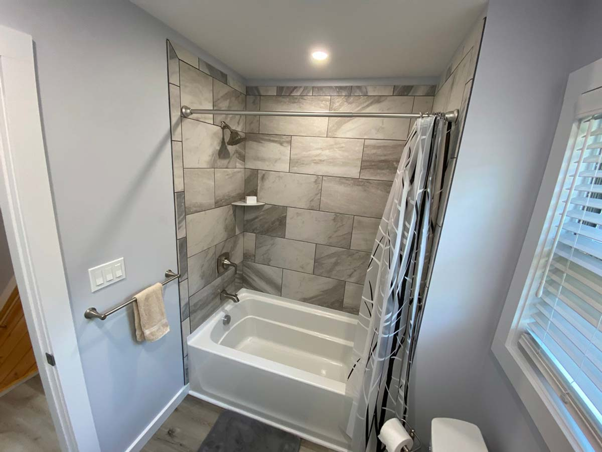 Tub and shower with tiled surround
