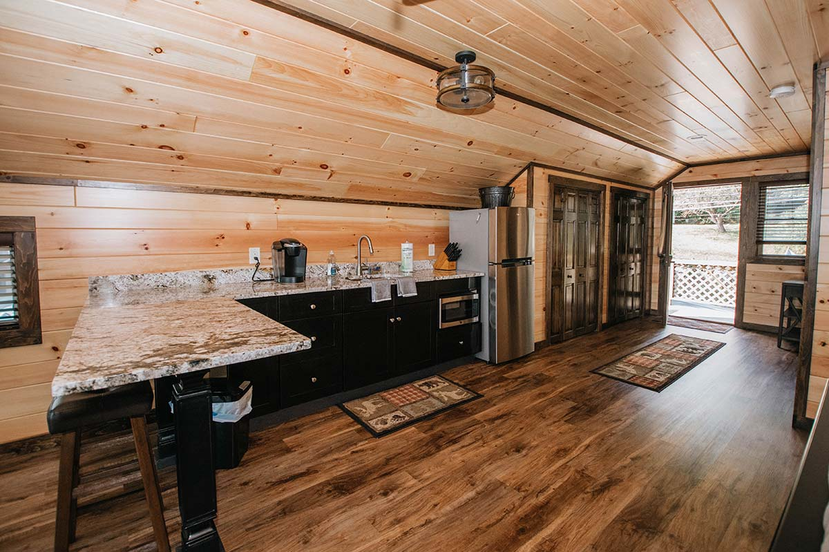 Large open kitchen area with peninsula for eating