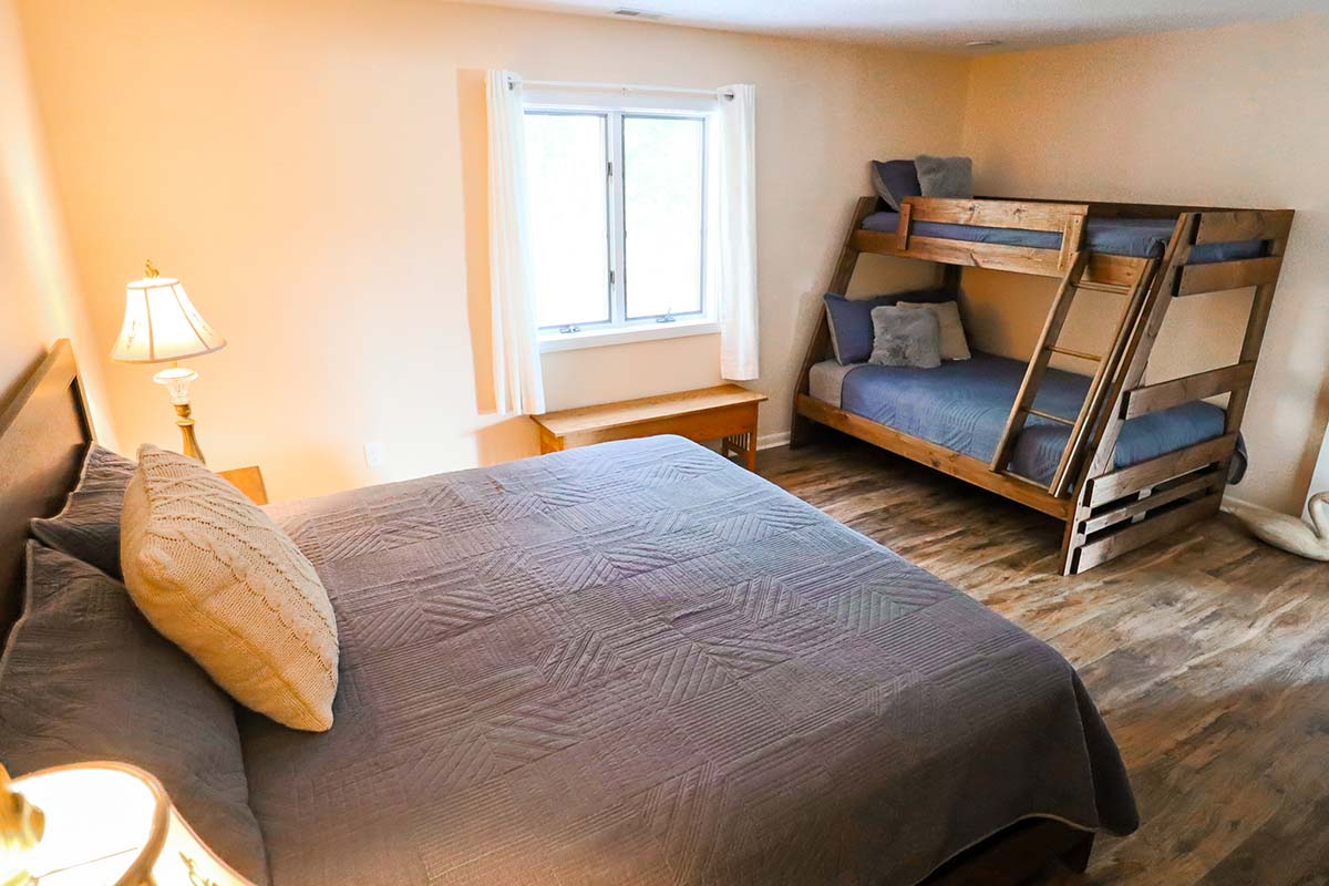 Sweetbriar Villa bedroom with queen and bunkbeds