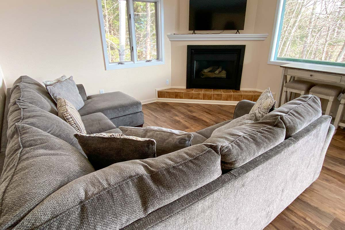 Sweetbriar Villa sectional by fireplace