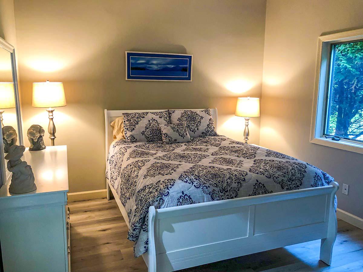 Queen bed in second bedroom on first floor