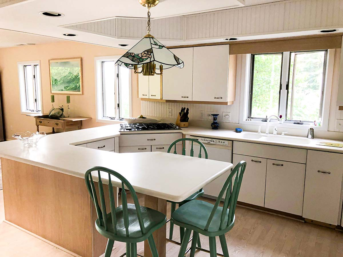Kitchen area with peninsula looking into dining area